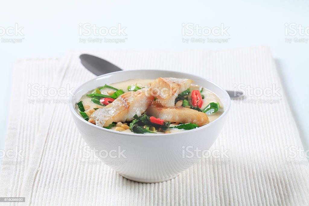 Creamy fish soup stock photo