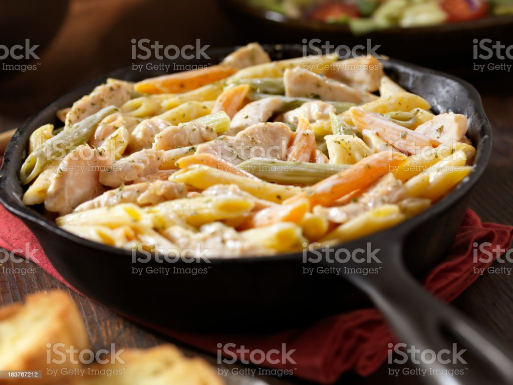 Creamy Garlic and Chicken Penne Dinner stock photo
