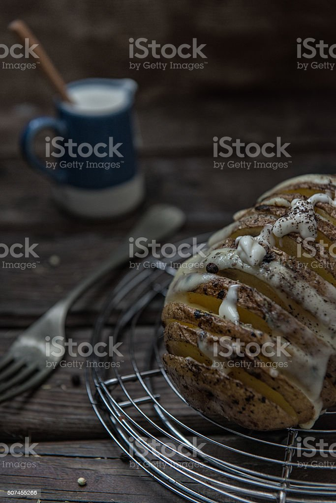 creamy hasselback potato stock photo