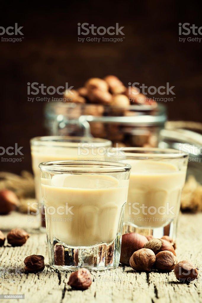 Creamy liqueur with hazelnuts stock photo