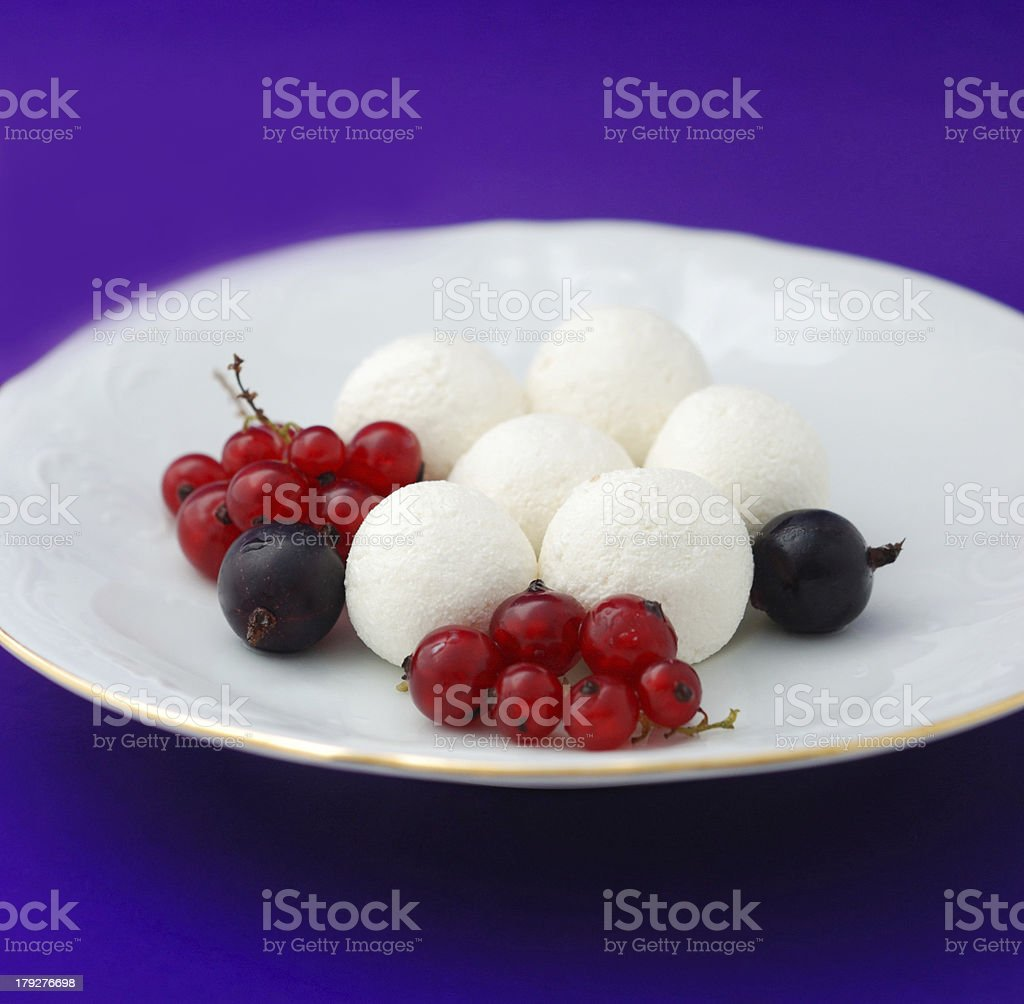 Creamy marbles with a currant and gooseberry royalty-free stock photo