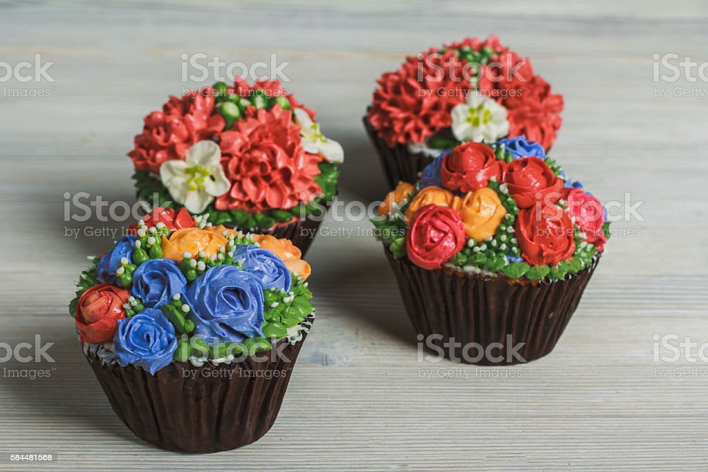 Creamy muffins with flowers stock photo