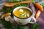 Creamy Mushroom Soup on old wooden background