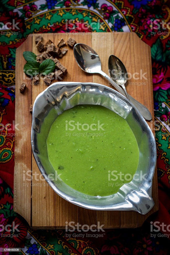 creamy pea soup with brown bread stock photo