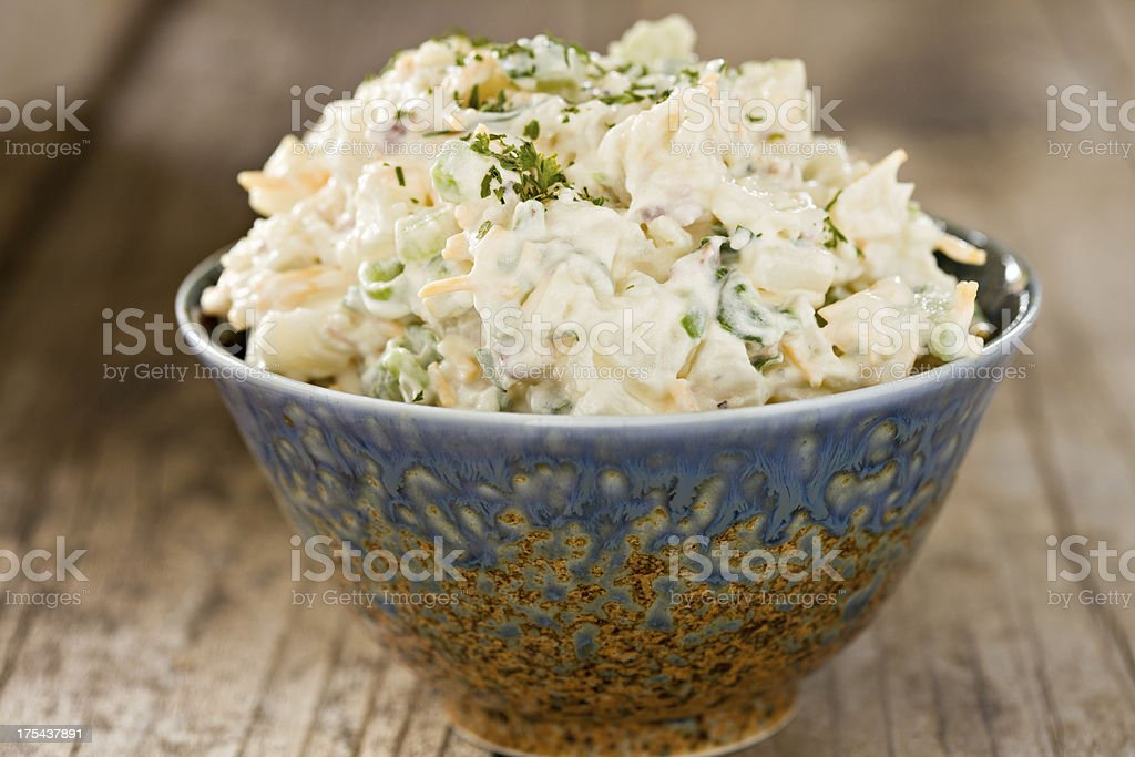 Creamy Potato Salad In A Fancy Blue Bowl stock photo