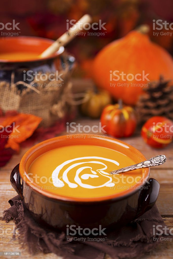 Creamy pumpkin soup on a rustic table royalty-free stock photo