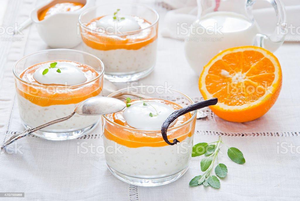 Creamy rice pudding with tangy orange custard stock photo
