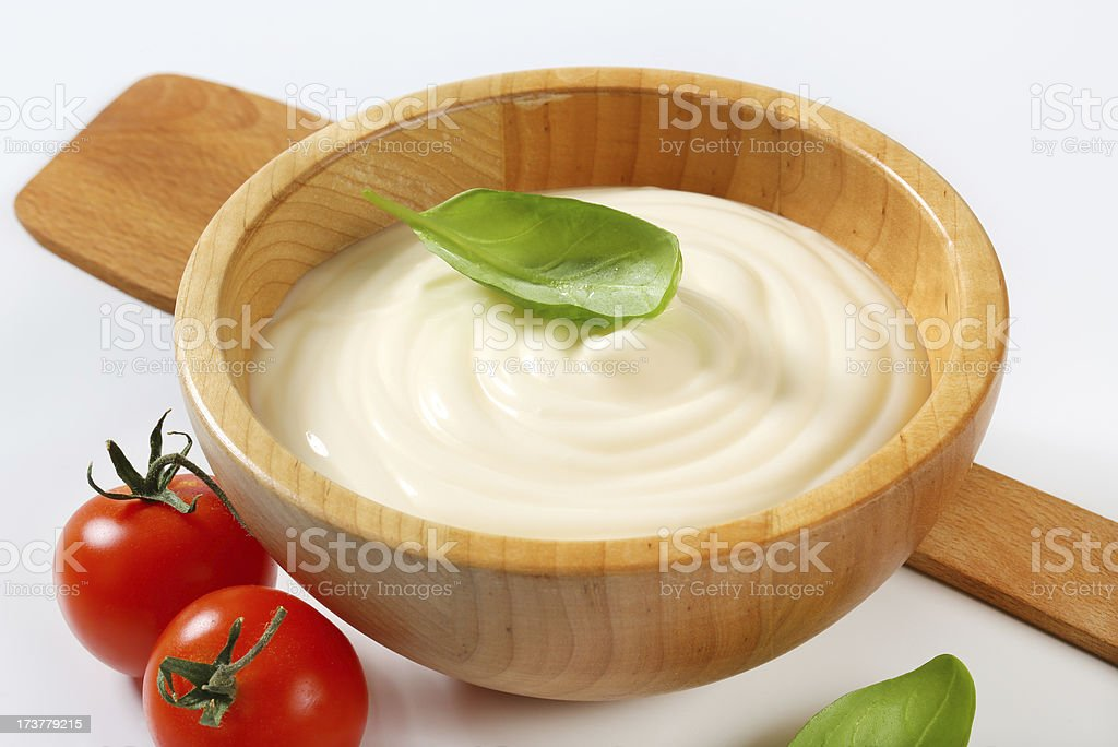 Creamy sauce in wooden bowl royalty-free stock photo