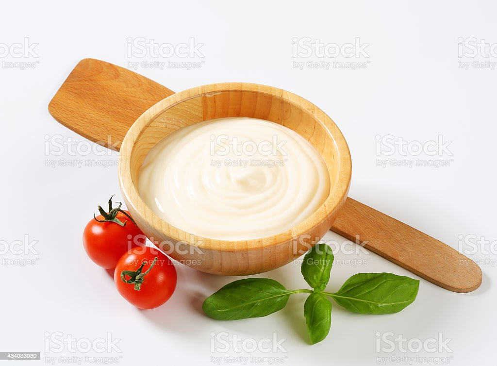 Creamy sauce in wooden bowl stock photo