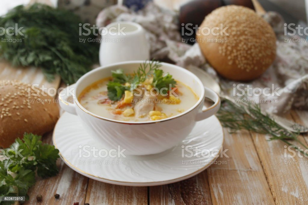 Creamy soup with corn and chicken stock photo