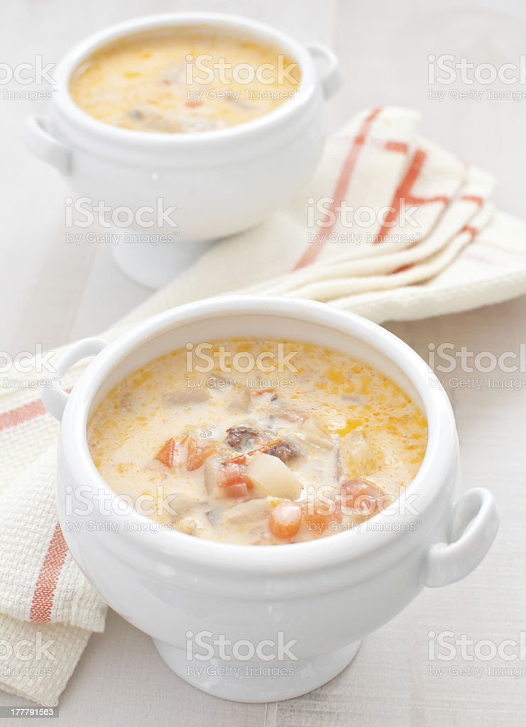 Creamy soup with vegetables ad fish stock photo