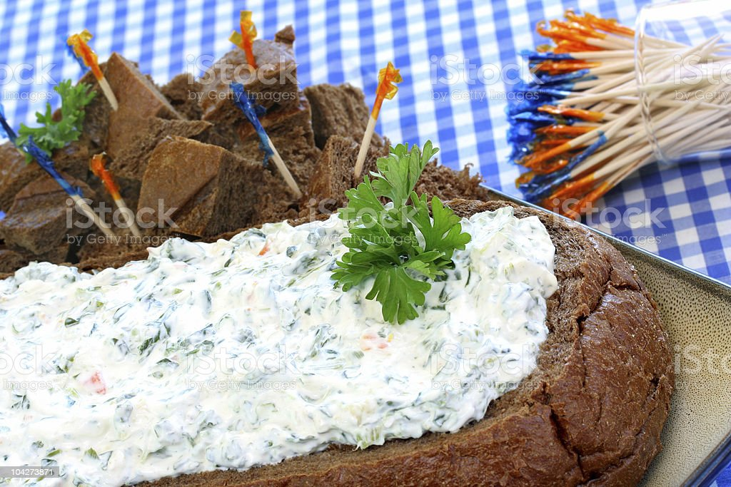 Creamy Sour Cream and Spinach Dip in a Pumpernickel Loaf royalty-free stock photo