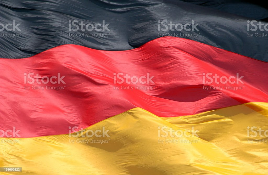 Creased and crumpled German flag stock photo