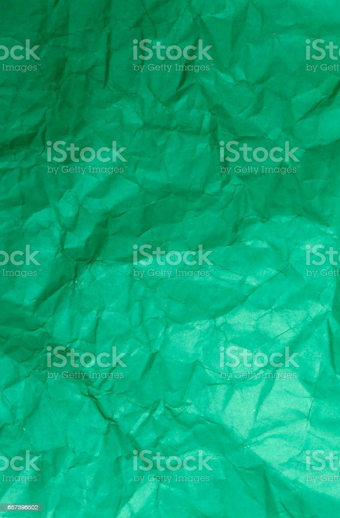 creased green paper. stock photo