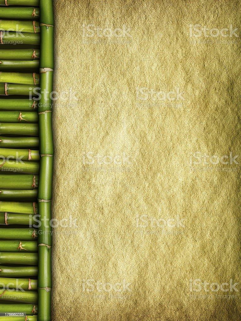 Creased handmade paper sheet and bamboo sticks royalty-free stock photo