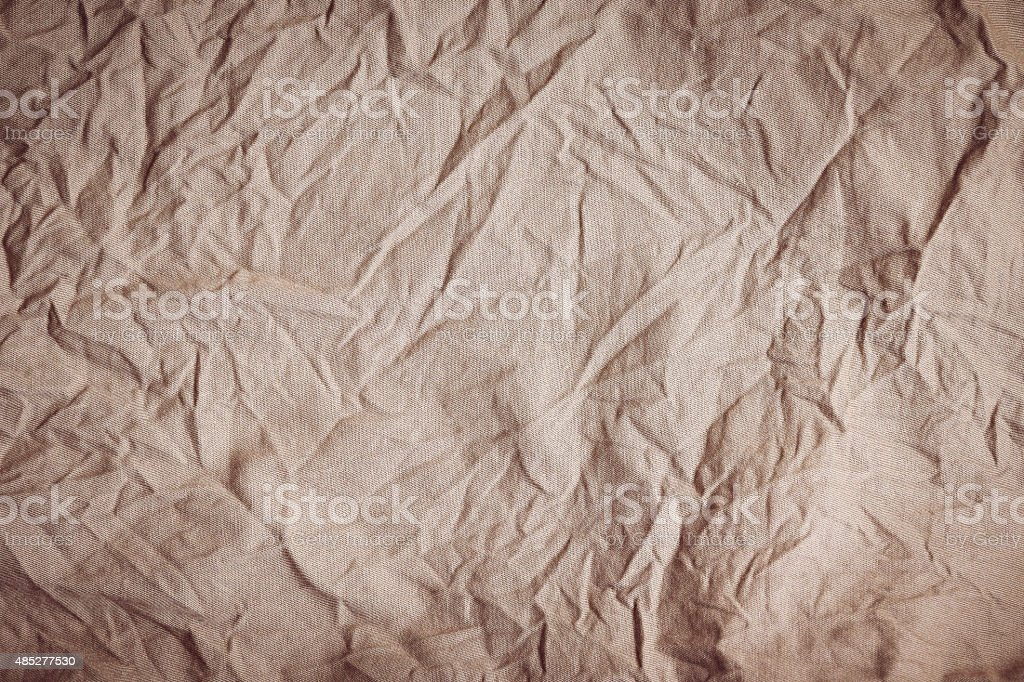 Creases, wrinkles, brown fabric texture for background. stock photo