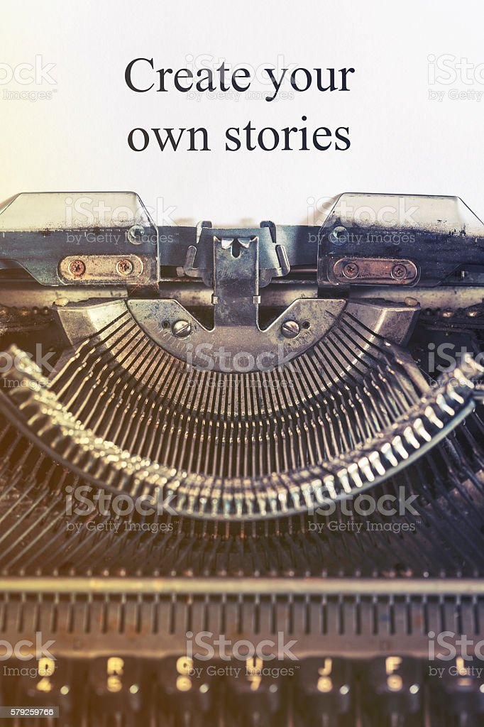 Create your own stories message written on a vintage typewriter stock photo