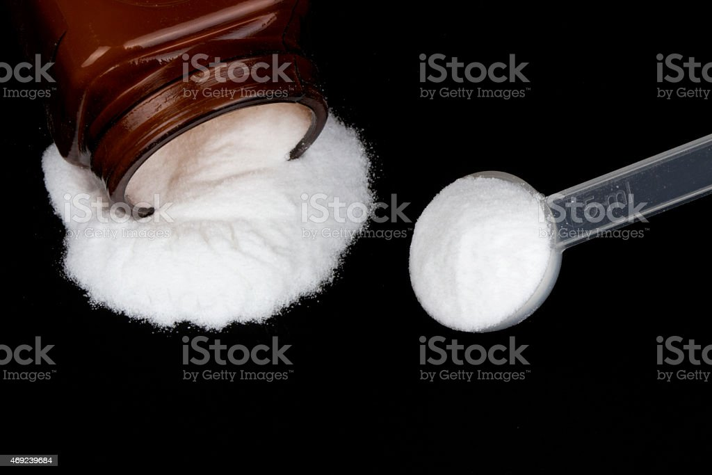 Creatine monohydrate on black background stock photo