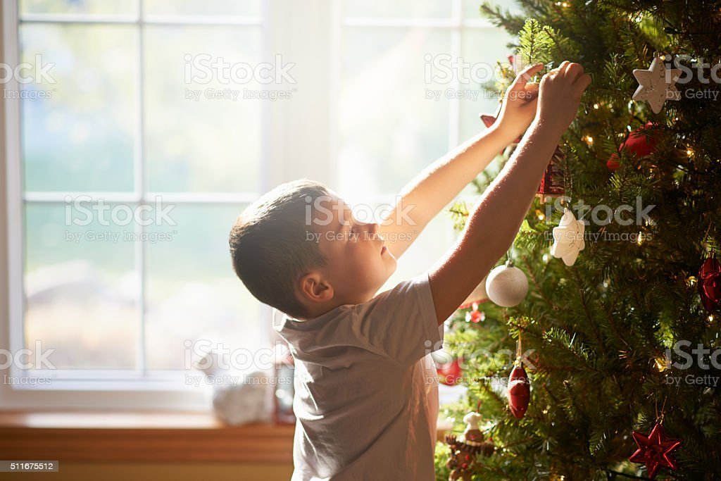 Creating a Christmas tree masterpiece stock photo