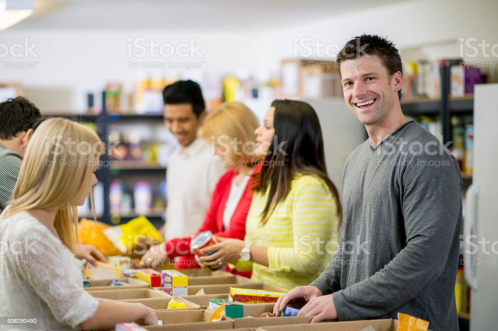Creating Food Boxes for the Homeless stock photo