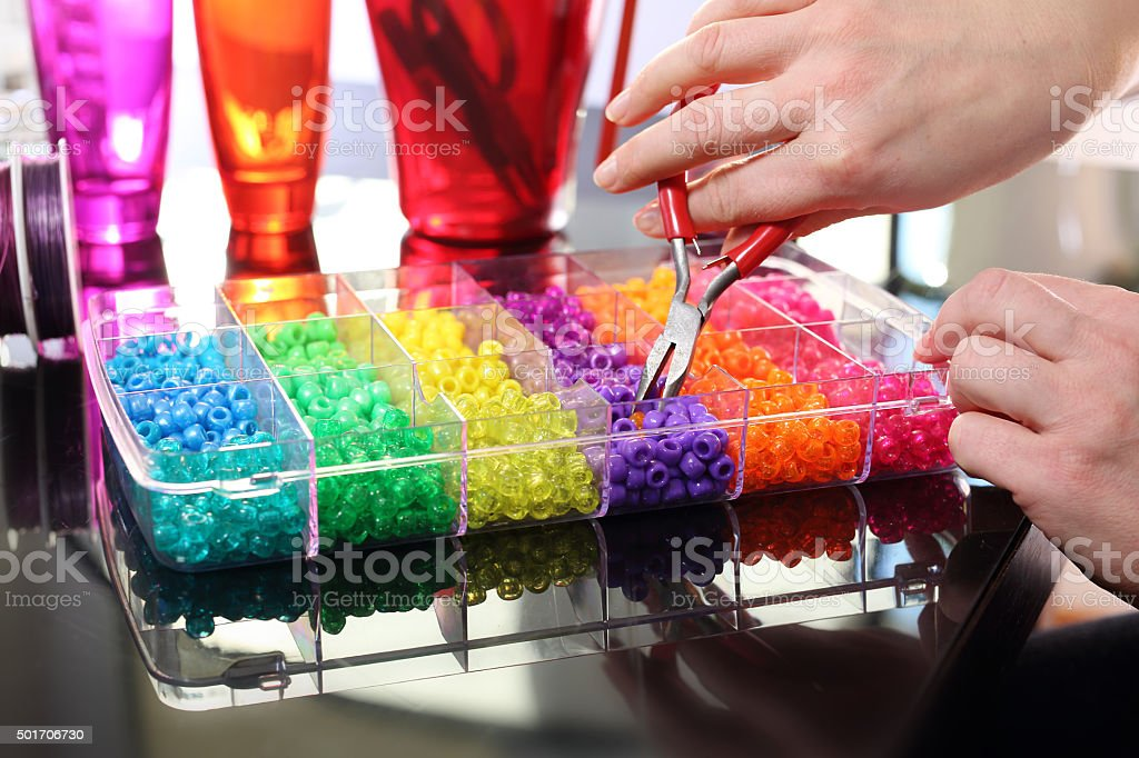 Creating jewelry. stock photo