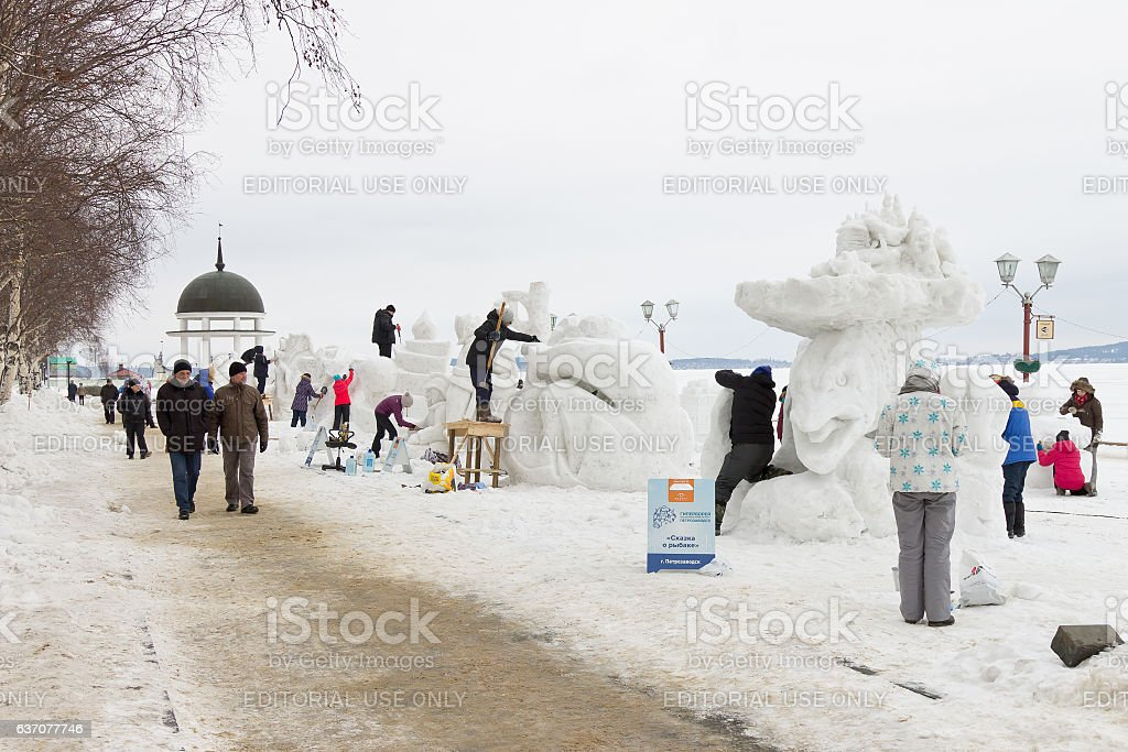 Creating of snow sculptures stock photo