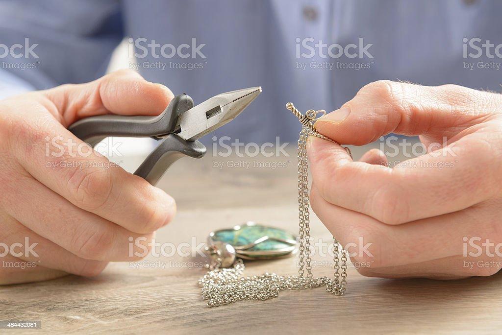 Creating or fixing jewelry stock photo