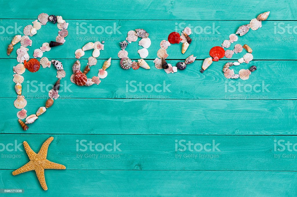 Creative Beach sign formed of assorted sea shells stock photo