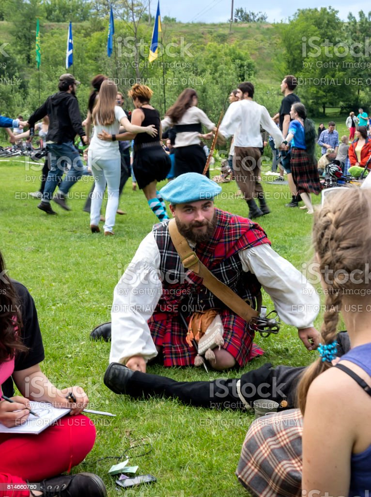 A creative bearded guy in a Scottish kilt stock photo