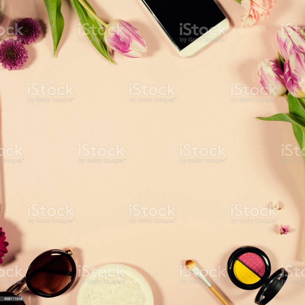 Creative beauty feminine arrangement of flowers and cosmetics stock photo
