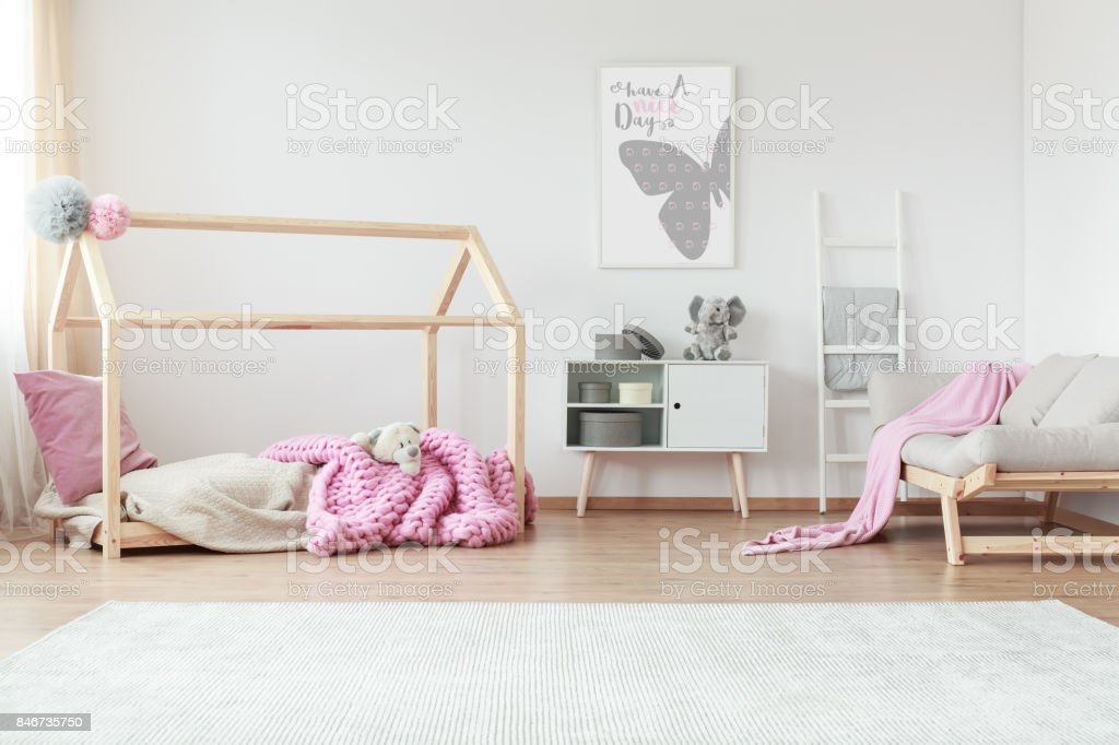 Creative bedroom with patterned blanket stock photo