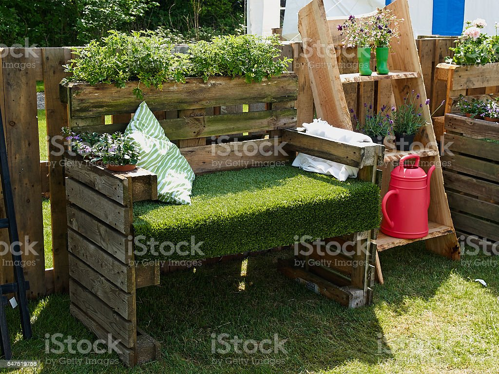 Creative bench in a garden stock photo