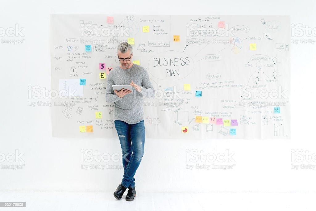 Creative business man making a business plan stock photo