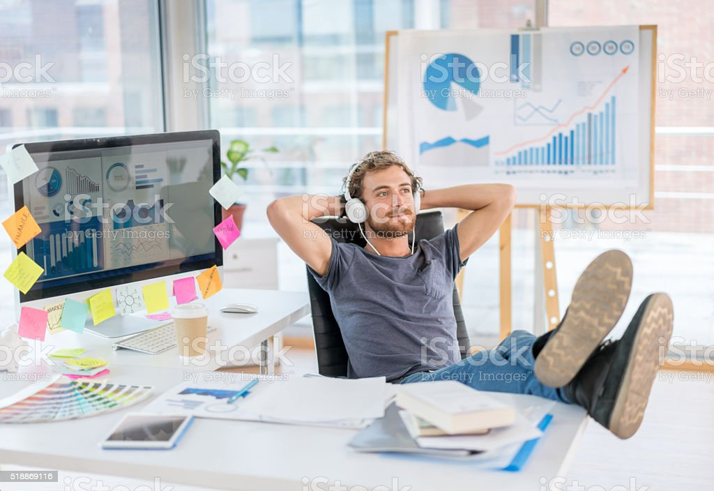 Creative business man relaxing at the office stock photo