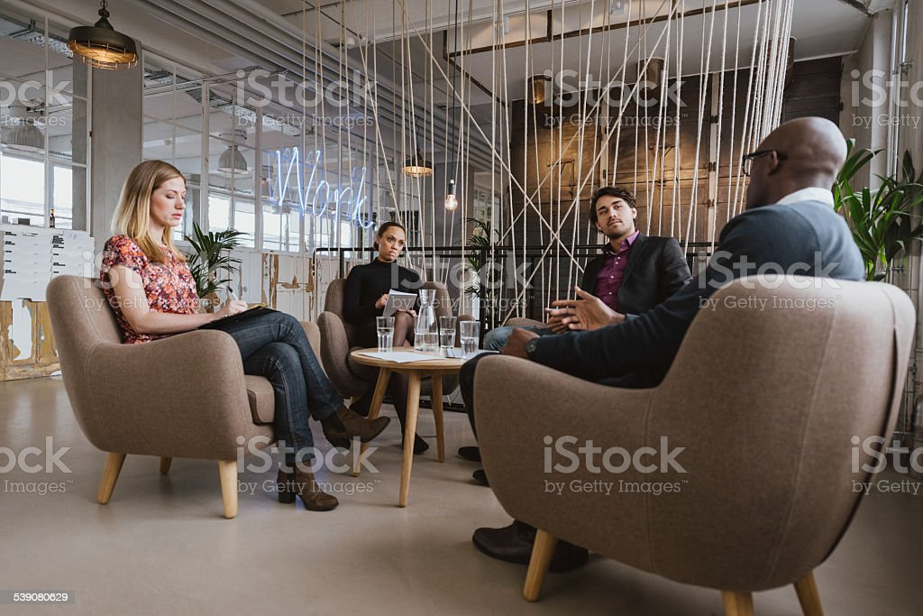 Creative business people discussing new project stock photo