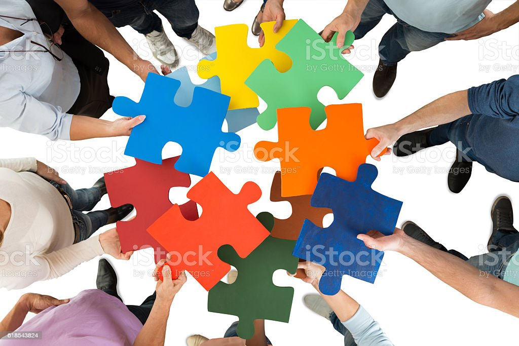 Creative Business People Holding Colorful Puzzle Pieces stock photo