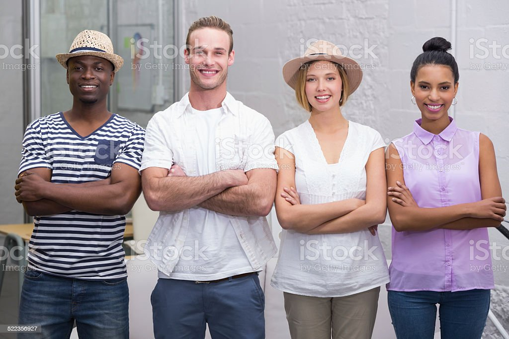 Creative business people with arms crossed in office stock photo