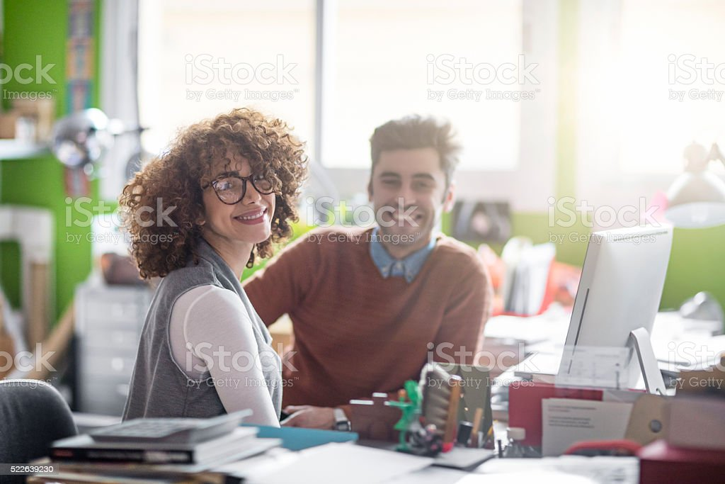 Creative business people working together at a computer stock photo