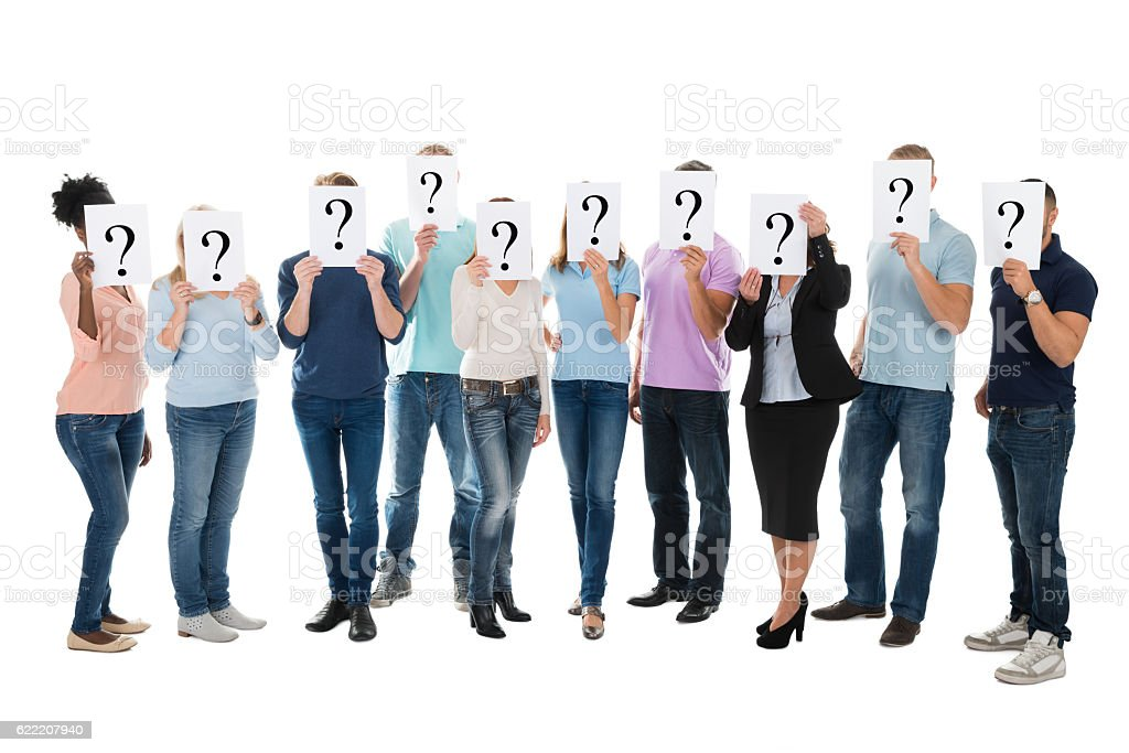 Creative Business Team Hiding Faces With Question Mark Signs stock photo