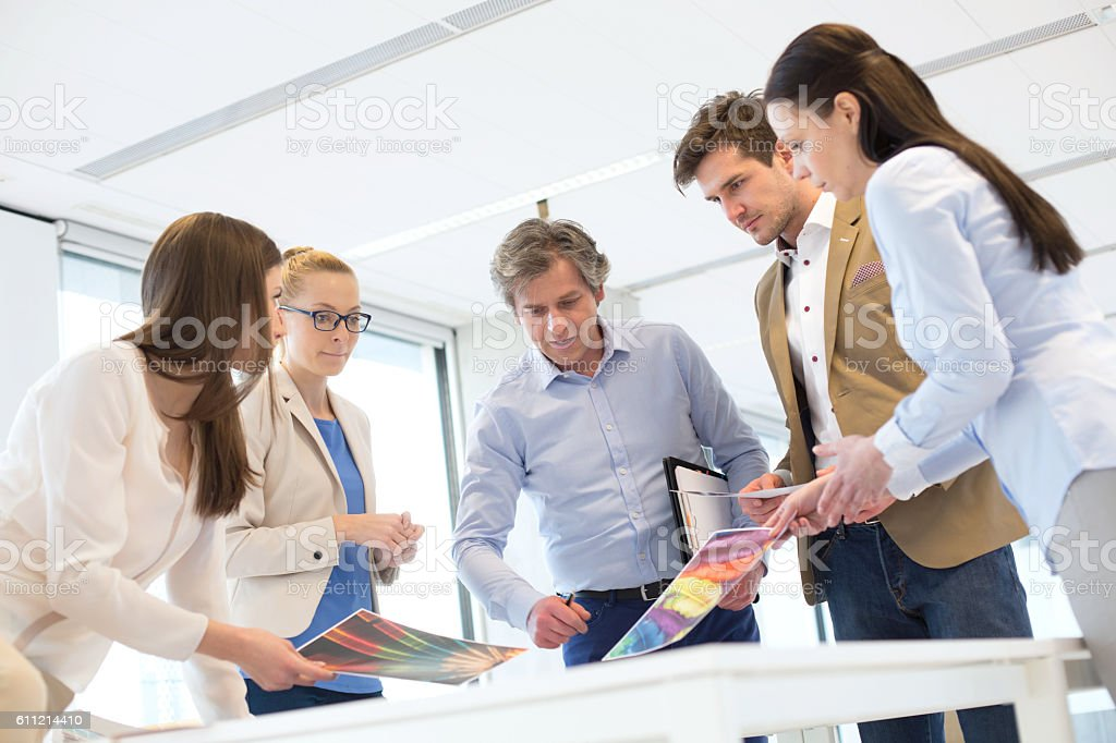 Creative business team working on new project at office stock photo