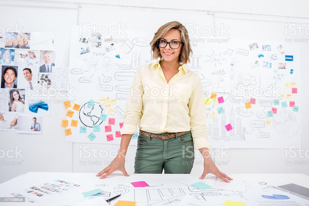 Creative business woman at the office stock photo