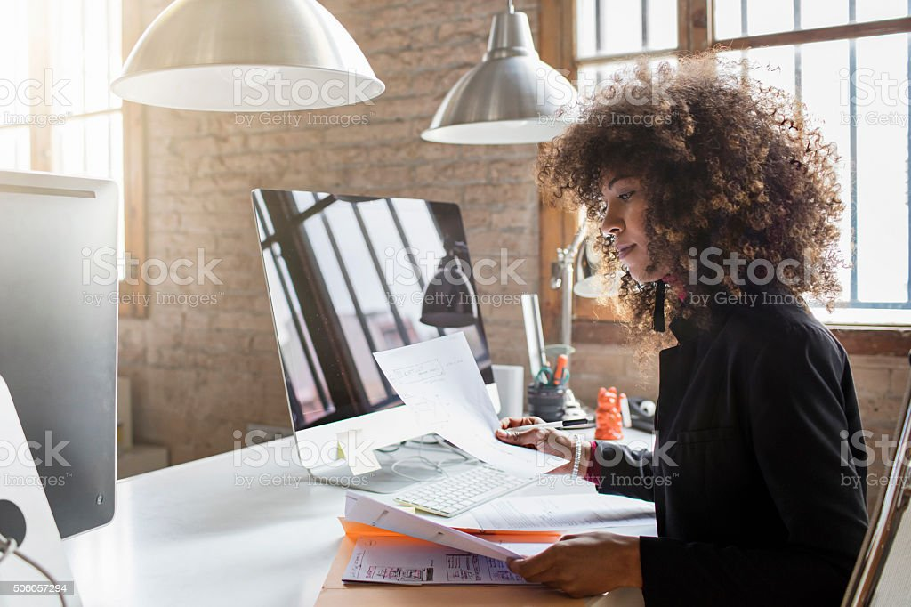 Creative businesswoman working in the office stock photo