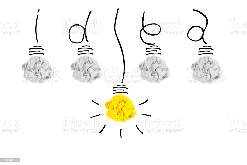 Creative concept. Yellow light bulb outstanding on  bulb crumpled paper and wires that wrapped be word idea on white background stock photo