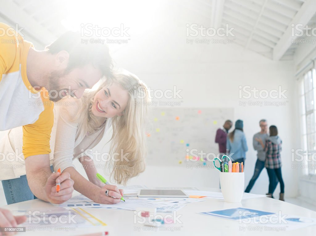 Creative couple working at the office stock photo