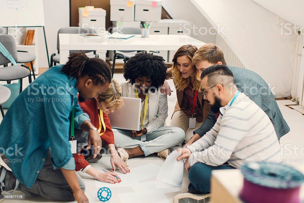 Creative Designer Brainstorming On Floor In Office. stock photo