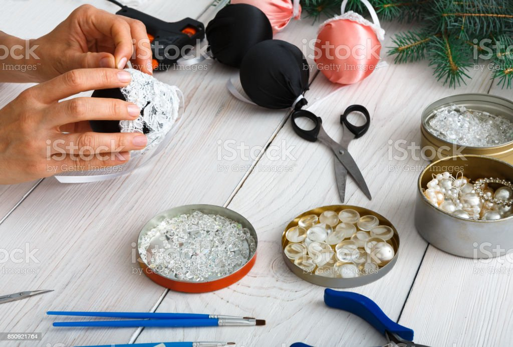 Creative diy craft hobby. Handmade christmas decoration, balls and garland stock photo