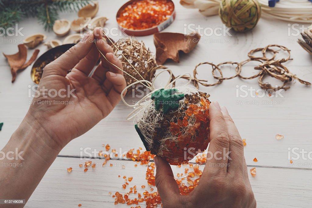 Creative diy hobby. Handmade craft christmas decoration, balls and garland stock photo