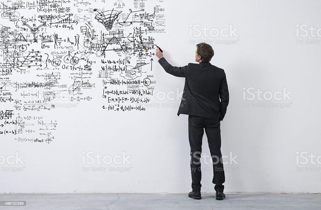 Creative entrepreneur sketching ideas stock photo