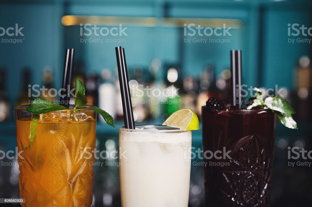 Creative exotic alcohol cocktails in night club bar stock photo
