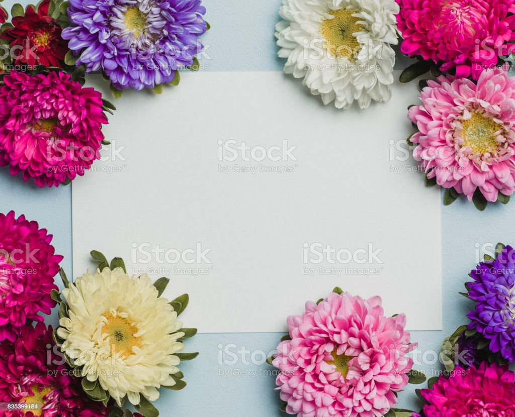 Creative flower arrangement frame with paper note. Place for text.